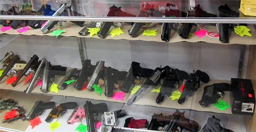 guns in glass case